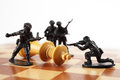War Concept. Toy Soldiers Kill Chess King. Death Of King. Royalty Free Stock Image - 67790176