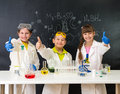 Three Little Students On Chemistry Lesson In Lab Stock Photography - 67796232