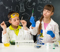 Two Little Students On Chemistry Lesson In Lab Stock Photo - 67796250