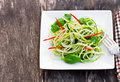 Zucchini  Spaghetti Salad With Basil And Paprica On Squared Plat Stock Photography - 67799492