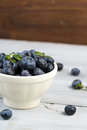 Ceramic Bowl With Fresh Blueberries On A Wooden Background Stock Images - 67808824