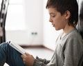 Boy Reading Book Royalty Free Stock Photography - 67811027