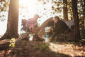 Couple Cooking Food Outdoors On A Camping Trip Royalty Free Stock Images - 67839529