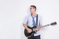 Relaxing Asian Business Man Playing Electric Guitar Near The Whi Stock Image - 67856911