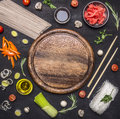 Raw Buckwheat Noodles With Vegetables, Ginger, Chopsticks And Ingredients, Laid Out Around Cutting Board Place For Text,frame Royalty Free Stock Photo - 67865185