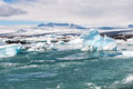 Floating Icebergs And View To The Glacier, Ice Lagoon Jokulsarlon, Iceland Royalty Free Stock Images - 67896089