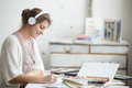 Cheerful Young Woman Listening Music At Work Royalty Free Stock Photography - 67903287
