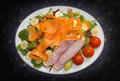 Healthy Salad Of Ham, Tomatoes, Carrots, Bananas, Rocket, Lettuce Green Olives And Grapes. Stock Photography - 67922722