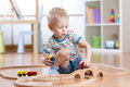 Child Playing Rail Road Toy In Nursery Royalty Free Stock Photo - 67954035