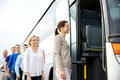 Group Of Happy Passengers Boarding Travel Bus Stock Images - 67960354