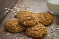 Oatmeal Cookies With Sesame Seeds And Glass Of Milk Stock Images - 68045054
