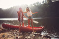 Couple After The Canoe Ride Royalty Free Stock Photo - 68053305