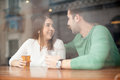 Cute Girl Flirting With A Guy At The Bar Stock Photography - 68073482