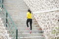 Young Asian Woman Exercising Outdoor In Yellow Jacket, Jogging G Royalty Free Stock Photos - 68094028