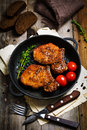 Spicy Grilled Pork Chops In Skillet Royalty Free Stock Photography - 68097357