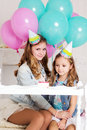 Two Girls Are Making Wish For Birthday With Candle Royalty Free Stock Image - 68104586