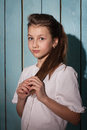 Studio Portrait Of Beautiful Girl With Big Eyes Who Holding Her Stock Photography - 68117622