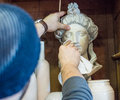 Artist/teacher Cleaning Sculptures With A Piece Of Cloth - Close Up Shot Stock Photo - 68130920
