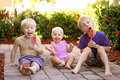 Three Children Eating Fruit Popsicles Outside On Summer Day Stock Photo - 68141890