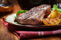 Portions Of Grilled Beef Steak With Grilled Potatoes And Paprika Royalty Free Stock Image - 68146036