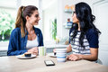 Young Female Friends Talking While Having Breakfast Royalty Free Stock Photography - 68158697