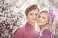 Man And Woman In The Blossoming Garden Royalty Free Stock Photography - 68163847