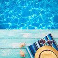 Summer Holidays In Beach Seashore. Fashion Accessories Summer Flip Flops, Hat, Sunglasses On Bright Turquoise Board Near The Pool Stock Photos - 68171873