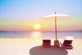 Tropical Beach In Sunset With Beach Chairs And Umbrella Royalty Free Stock Photography - 68180087