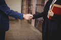 Midsection Of Female Lawyer Handshaking With Client Royalty Free Stock Images - 68186129