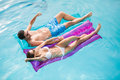 Couple Relaxing On Inflatable Raft Royalty Free Stock Photography - 68196817