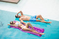 Smiling Couple Relaxing On Inflatable Raft Stock Photos - 68196933