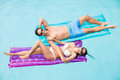 Cheerful Couple Relaxing On Inflatable Raft Stock Photos - 68197113