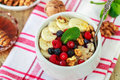 Oatmeal With Fresh Berries, Bananas Nuts And Honey.  Healthy Breakfast Stock Photo - 68210660