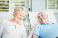 Happy Senior Couple Relaxing On Lounge Chair Royalty Free Stock Photography - 68210917