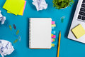 Office Table Desk With Set Of Colorful Supplies, White Blank Note Pad, Cup, Pen, Pc, Crumpled Paper, Flower On Blue Stock Images - 68212914