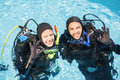 Couple Practicing Scuba Diving Together Royalty Free Stock Images - 68235919