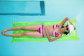 Happy Woman In Bikini Lying On Air Bed In Swimming Pool Royalty Free Stock Image - 68237286
