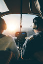 Pilots Flying A Helicopter On Sunny Day Stock Photography - 68244822