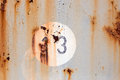 Number 13 On Old Painted And Rusted Metal Panel Stock Photography - 68248172