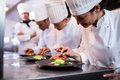 Chef Decorating A Food Plate Royalty Free Stock Images - 68255489