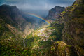 Rainbow Above Mountain Village Royalty Free Stock Photo - 68276245
