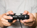 A Young Man Holding Game Controller Playing Video Games Royalty Free Stock Photography - 68306677