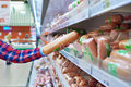 Woman Chooses Sausages In Store Royalty Free Stock Photography - 68314137