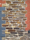 Old Stone And Painted Brick Decorated Wall. Stock Image - 68321031