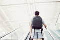 Student Going Up Escalator Royalty Free Stock Image - 68331086