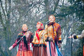 The Group Of Women In Traditional Russian Clothers Sing A Song On Maslenitsa In Moscow. Royalty Free Stock Image - 68335716