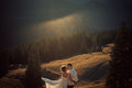 Happy Wedding Couple Kiss On Sunset In The Mountains. Honeymoon. Royalty Free Stock Images - 68340019