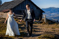 Happy Wedding Couple On The Countryard. Honeymoon In Mountains Royalty Free Stock Photography - 68341057
