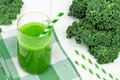 Green Kale Smoothie With Straws On Checkered Cloth Royalty Free Stock Photo - 68345285