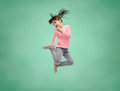 Happy Little Girl Jumping In Air Over School Board Royalty Free Stock Photography - 68364797